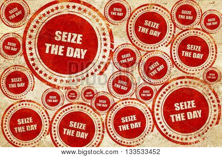 seize the day, red stamp on a grunge paper texture