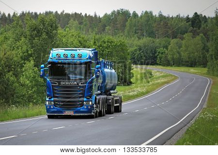 SALO, FINLAND - JUNE 5, 2016: New blue Scania Euro 6 tank truck for bulk transport on summer highway in South of Finland.