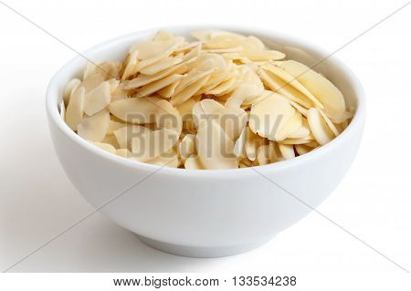 White Bowl Of Peeled Flaked Almonds Isolated On White.