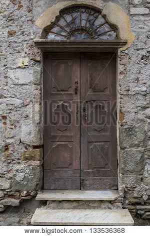 Old wooden door in Mombaldone in Piedmont Italy.