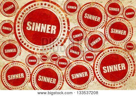 sinner, red stamp on a grunge paper texture