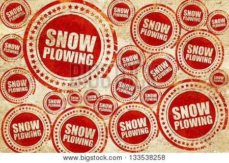snow plowing, red stamp on a grunge paper texture