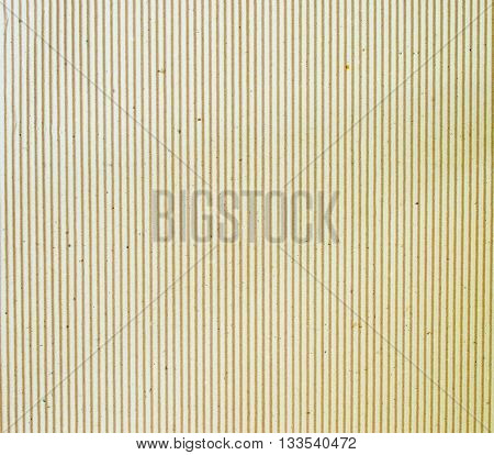 The brown cardboard corrugated pattern background vertical