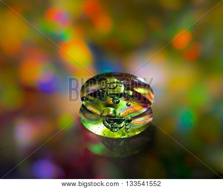 A drop of soap, close-up. The unusual shape, bright colors. Concepts, ideas - something that UFOs, strange shape. The liquid molten metal, bubble, abstract