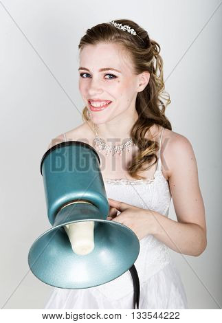 beautiful bride screaming into a bullhorn. Wedding day. funny bride concept.