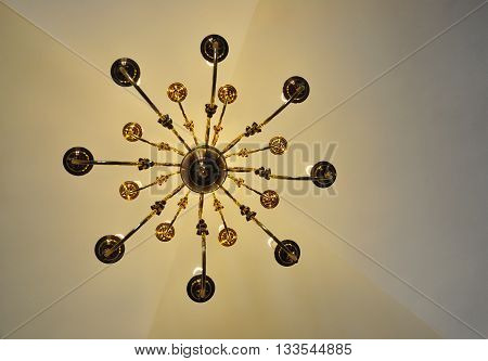 chandelier vintage, view from below, natural lights, old ceiling background