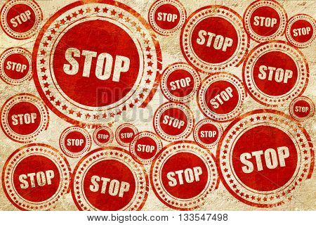 stop, red stamp on a grunge paper texture