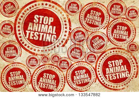 stop animal testing, red stamp on a grunge paper texture