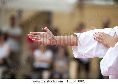 Karate practitioner hand in focus against blurred background