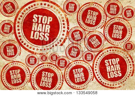 stop hair loss, red stamp on a grunge paper texture