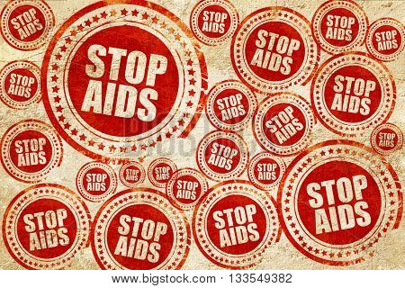 stop aids, red stamp on a grunge paper texture