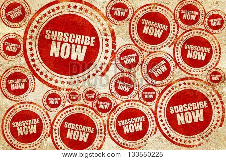 subscribe now, red stamp on a grunge paper texture