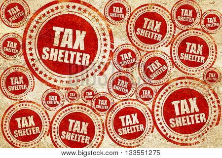 tax shelter, red stamp on a grunge paper texture