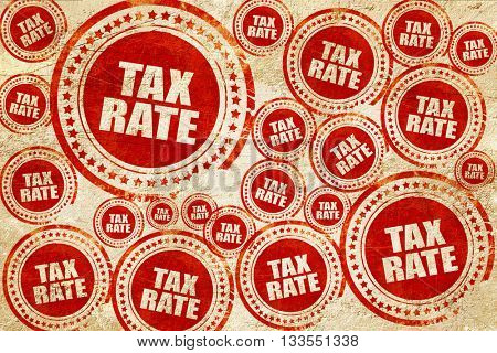 tax rate, red stamp on a grunge paper texture
