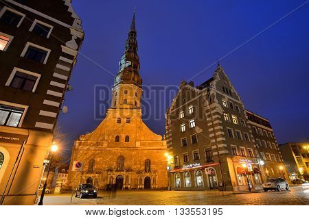 RIGA LATVIA - MARCH 10: old town and St. Peter's Church on March 10 2015 in Riga Latvia. It is a parish church of the Evangelical Lutheran Church of Latvia.