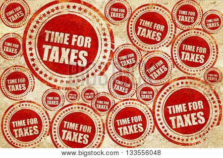 time for taxes, red stamp on a grunge paper texture