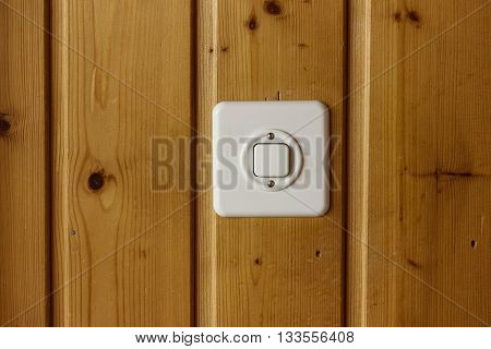 white light switch on brown wooden boards