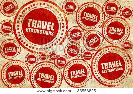 travel restrictions, red stamp on a grunge paper texture