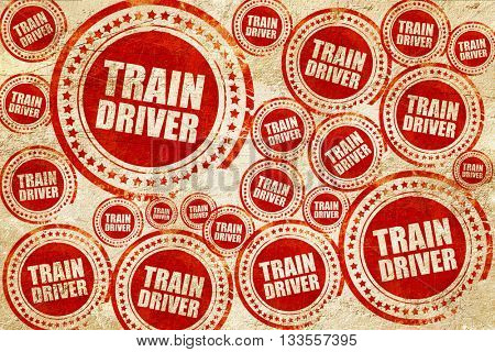 train driver, red stamp on a grunge paper texture