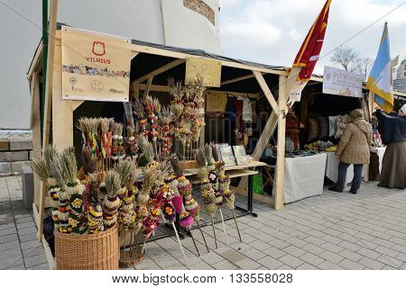VILNIUS LITHUANIA - MARCH 6: Unidentified people trade traditional palm bouquets in annual traditional crafts fair - Kaziuko fair on Mar 6 2015 in Vilnius Lithuania