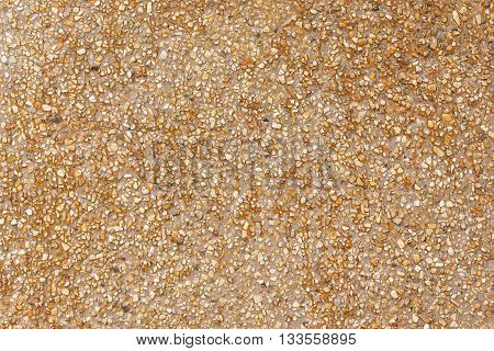 Natural sea sand texture rough texture surface of exposed aggregate finish Ground stone washed floor made of small sand stone.