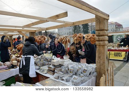 VILNIUS LITHUANIA - MARCH 6: Unidentified people trade home made bread in annual traditional crafts fair - Kaziuko fair on Mar 6 2015 in Vilnius Lithuania