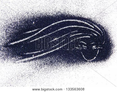 Silhouette of a girl with long hair of black glitter on white background