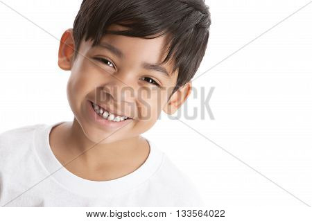 Portrait of a smiling mixed race boy. Isolated on white with room for your text.