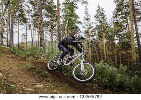 Miass Russia - May 29 2016: rider on a bicycle coming down mountain at high speed during Cup