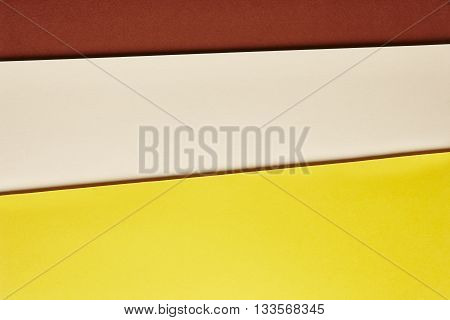Colored cardboards background in brown beige yellow tone. Copy space. Horizontal