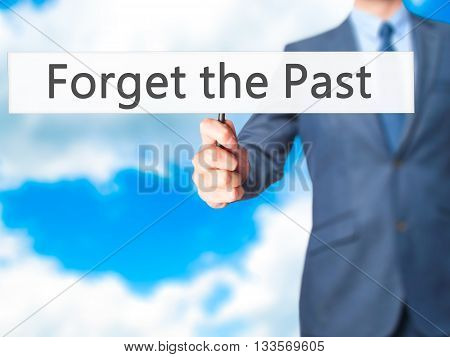 Forget The Past - Businessman Hand Holding Sign