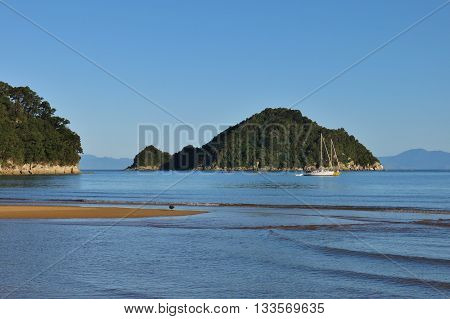 Small island in the Onetahuti Bay. Abel Tasman National Park New Zealand.
