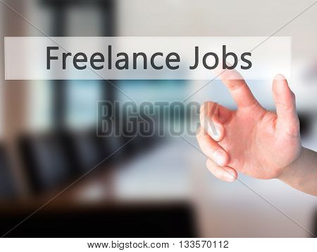 Freelance Jobs - Hand Pressing A Button On Blurred Background Concept On Visual Screen.