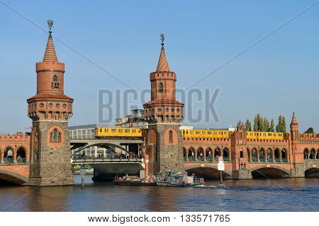 BERLIN OCTOBER 27: Oberbaumbruecke (Oberbaum bridge) river Spree on October 27 2014 in Berlin Germany. Oberbaumbruecke is one of the most popular landmarks of the city.