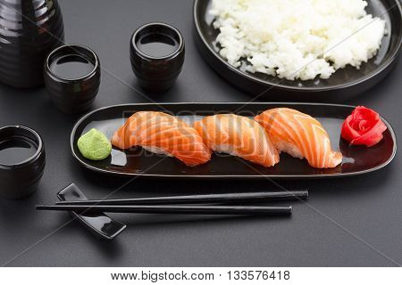 Japanese Cuisine. Sushi Roll With Soy Sauce Over Black Background.