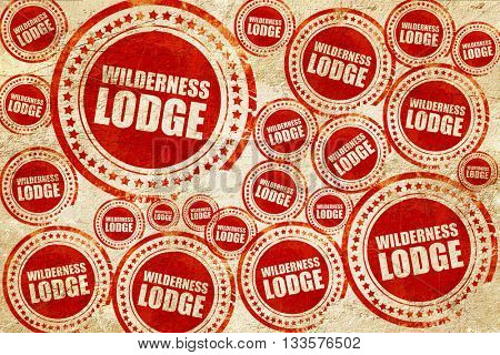 wilderness lodge, red stamp on a grunge paper texture