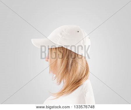 Blank white baseball cap mockup template, wear on women head, isolated, profile. Cotton baseball cap design on delivery guy.