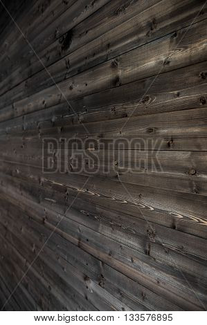 old, grunge wood panels used as background side view.