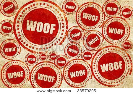 woof, red stamp on a grunge paper texture
