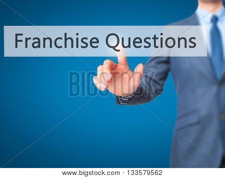 Franchise Questions - Businessman Hand Pressing Button On Touch Screen Interface.