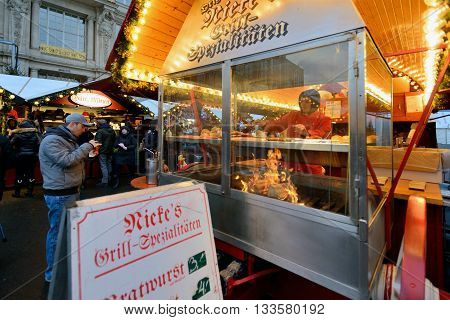 BERLIN - DECEMBER 25: Unidentified people trades food in annual traditional Christmas fair on 25 December 2014 in Berlin Germany.
