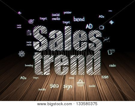Marketing concept: Glowing text Sales Trend,  Hand Drawn Marketing Icons in grunge dark room with Wooden Floor, black background