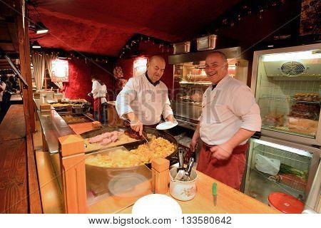 BERLIN - DECEMBER 25: Unidentified people trades food in annual traditional Christmas fair in Alexanderplatz on 25 December 2014 in Berlin Germany.