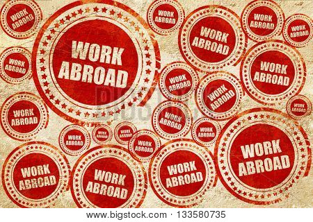 work abroad, red stamp on a grunge paper texture