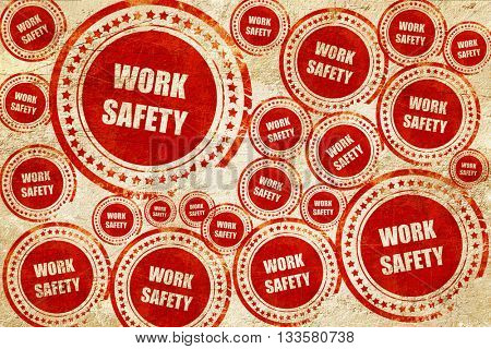 Work safety sign, red stamp on a grunge paper texture