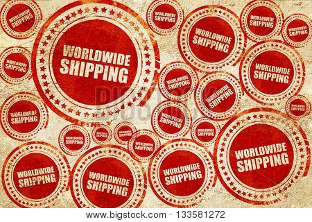 worldwide shipping, red stamp on a grunge paper texture