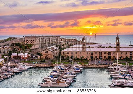 KINGS WHARF BERMUDA MAY 25 - Kings Wharf at sunset with the clock towers and Casemates Prison on May 25 2016 in Bermuda.