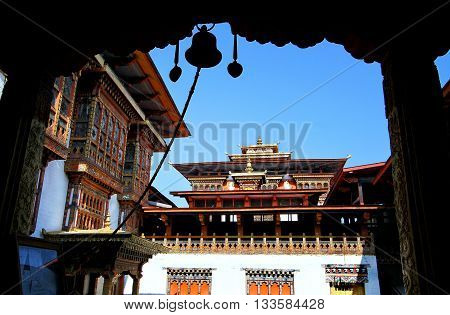 Silhouette of bell on Bhutanese architectural building at  Punakha dzong, Bhutan