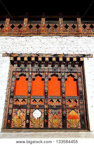 Local unique architectural details of wooden door in Bhutan.