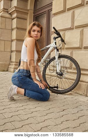 girl sad pretty pumps up bicycle tires